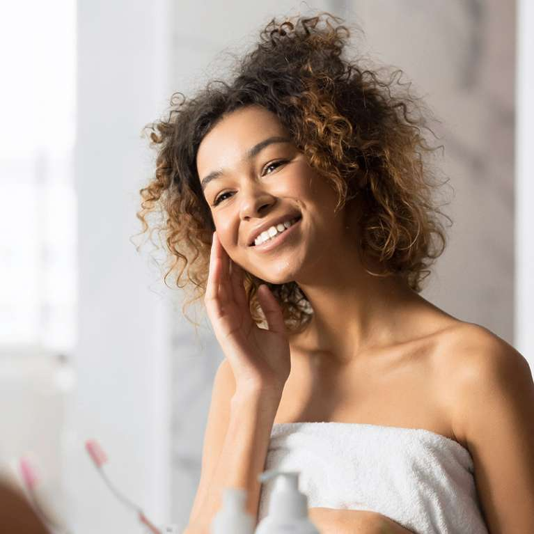 Woman smiling in bathroom
